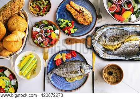 Lots Of Healthy Food Top View. Mediterranean Diet. Table With Food On Plates, Top View.healthy Dinne