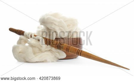 Heap Of Clean Wool With Wooden Spindle And Bowl Isolated On White