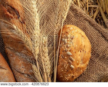 bread and heat ears on sackcloth in the summer haystack