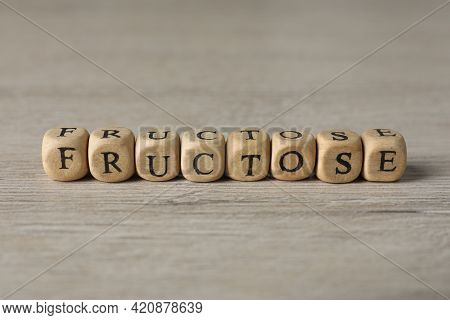 Word Fructose Made Of Wooden Cubes On Table, Closeup