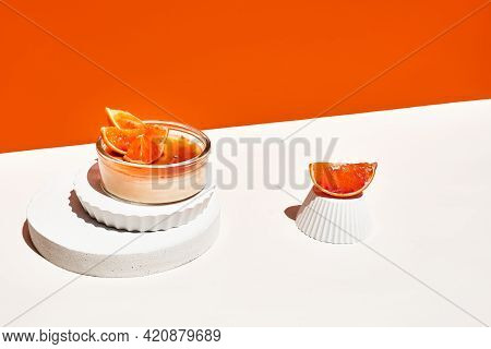 Creme Brulee French Dessert With Caramelized Brown Cane Sugar Orange Background. Two Portion Of Deli