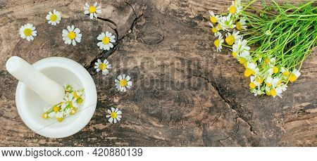 A Bouquet Of Daisies And A Mortar With Daisies On A Wooden Background With A Place For An Advertisin