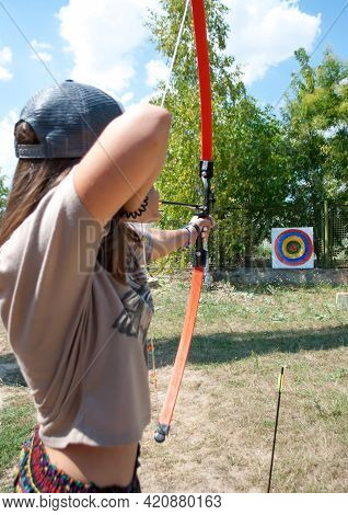 Odesa Rgn. Ukraine, August 4, 2018: Girl Aiming For Archery At A Target