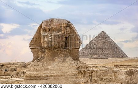 Great Sphinx And Pyramid Of Khafre. Ancient Egyptian Civilization. Landscape With Egyptian Pyramids.