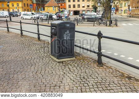 Beautiful View Of Metal Waste Container On Cobblestone Pavement Of European City. Sweden. Uppsala. 0
