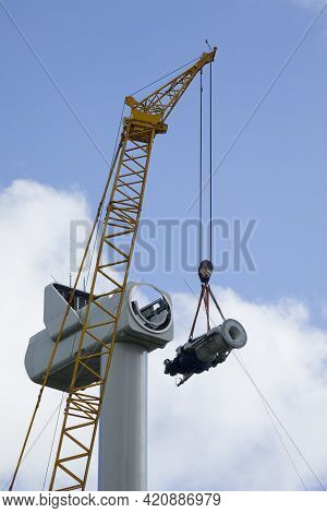 A Crawler Crane Is Hoisting The Gearbox Of A New Wind Turbine
