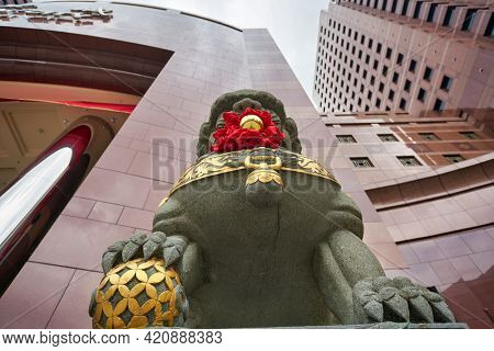SINGAPORE - CIRCA JANUARY, 2020: close up shot of guardian lion at Nge Ann City shopping center in the daytime.