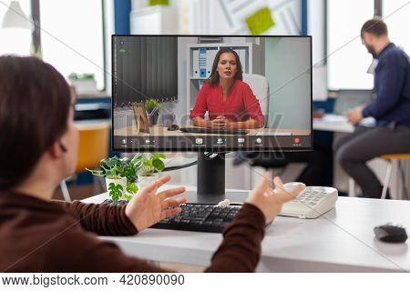 Invalid Disabled Immobilized Entrepreneur Talking With Remote Coworker During Video Conference, Onli