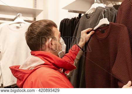 Masked Man Picks Things In Store, Knitwear