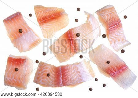 A Steak Of Flying Fish Falls Into The Pan. The Effect Of Flying Motion In The Cooking Process.isolat