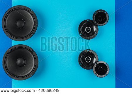 Car Audio System. A Set Of Speakers On A Blue Background.