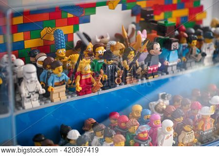 Tambov, Russian Federation - May 16, 2021 Lego Minifigures Standing In A Display Case. Shallow Depth