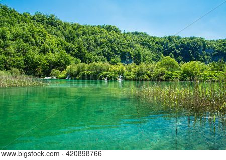 Overgrown Hills Behind A Lake Of Plitvice Lakes National Park.