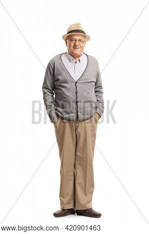 Full length portrait of a grandfather standing with hands in pockets and posing isolated on white background