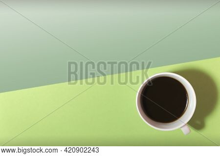 Cup Of Coffee On A Green And Light Green Background Top View