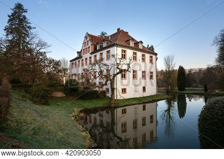 Castle Georghausen Close To Lindlar With Water Reflection At Evening Hours, Bergisches Land, Germany