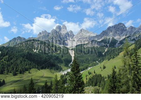 View Of The Vast Valley And Mountain Peaks Of The Austrian Alps.