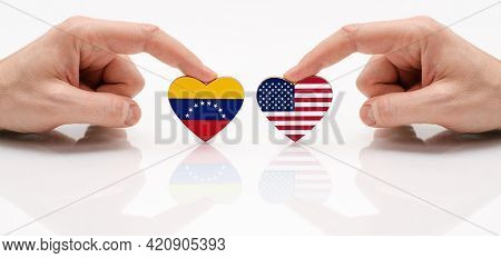 The Concept Of Friendship And Diplomatic Relations Between Venezuela And Usa. Two Male Hands Are Hol