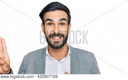 Young hispanic man wearing business clothes smiling swearing with hand on chest and fingers up, making a loyalty promise oath