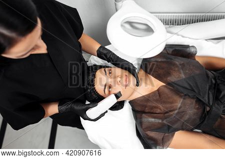 Cosmetologist Make Face While Procedure Ultrasound Cavitation Or Facial Peeling In Cosmetology Cabin