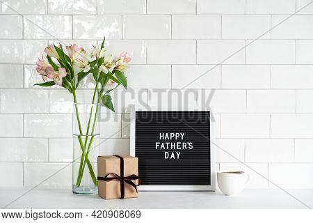 Happy Fathers Day Concept. Letterboard With Text Happy Father's Day, Gift Box, Cup Of Coffee, Buquet