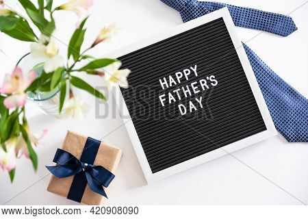 Happy Fathers Day Concept. Letter Board With Text Happy Father's Day, Necktie, Gift Box, Boquet Of F