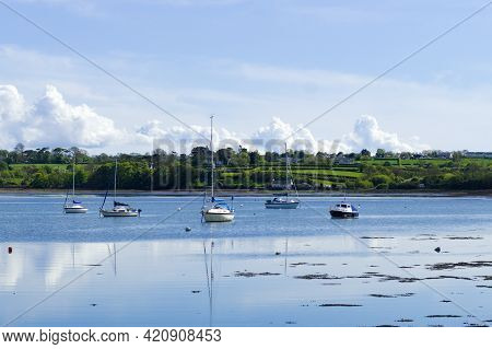 Red Wharf Bay, Anglesey, Wales. Beautiful Landscape Of Sea And Sand At Low Tide. Small Pleasure Boat
