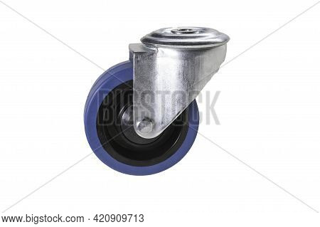 A Small Road Wheel From A Metal Trolley. Accessories Used For Transport In The Store And Factory.