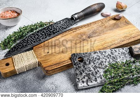 Old Meat Butcher Cleaver And Knife. White Background. Top View. Copy Space