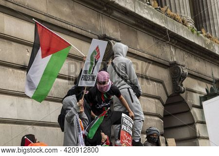 Nottingham, Nottinghamshire - May 15, 2021. Free Palestine Protesters With Placards And Flag On Top