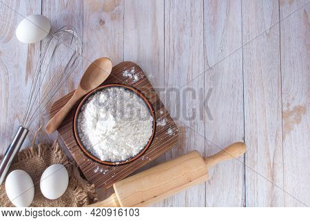 Homemade Flour Recipes (eggs, Flour, Sugar) And Rolling Pin On A Wooden Table, View From Above