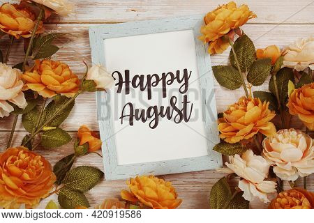 Happy August Typography Text With Flower Decoation On Wooden Background