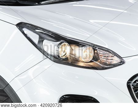 Novosibirsk, Russia - May 16, 2021: Kia Sportage, Headlight Of A Modern Popular Car Close-up. Shiny