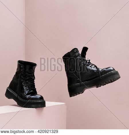 Cool combat boots with pink background
