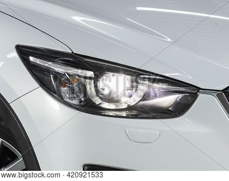 Novosibirsk, Russia - May 16, 2021: Mazda Cx-5, Headlight Of A Modern Popular Car Close-up. Shiny Gl