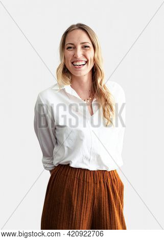 Cheerful stylist standing against a white wall
