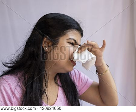 An Indian Asian Woman Facing Running Nose On White Background