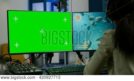 Black Woman Gamer Streaming Online Videogame On Powerful Computer With Green Screen Mock Up Chroma K