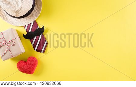 Happy Father's Day Background Concept With Tie And  Mustache, Hat, Gift Box, Red Heart  On Pastel Ye