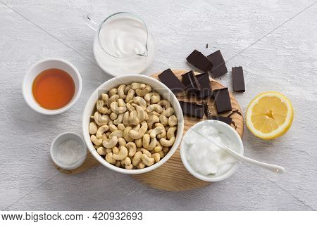 Ingredients For Delicious Vegan Chocolate Cashew Cheesecake: Cashews, Chocolate, Coconut Oil, Coconu