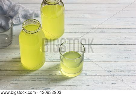 Healthy Dietary Milk Whey In Glass And Bottle On Light Blue Table, Space