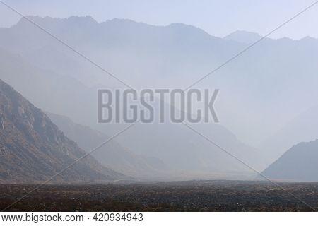 Haze Surrounding The Mountain Ridges And Peaks Of Mt San Jacinto Taken From The Arid Desert Floor Ne