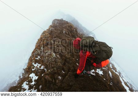 Hiker at Helvellyn summit in the English Lake District, England