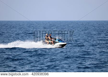 Kusadasi, Turkey - May 2021: Couple Rides A Water Scooter On The Aegean Sea. Water Sport, Riding A