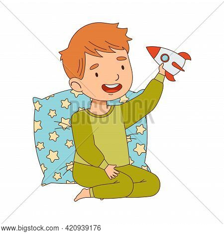 Cute Boy Sitting Near Pillow And Playing With Rocket Getting Ready To Bedtime Vector Illustration