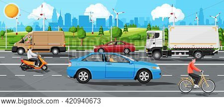 Suburb Road With Cargo Truck Trailer, Cars, Van And Motorbike. Road Over Hills And Forest Landscape.