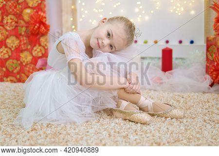 Little ballerina on scene. Children dance ?lassical ballet in studio. .