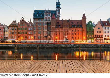 Facades Of Old Medieval Houses On The Promenade In Gdansk City. Poland. Riverside View From Wooden P