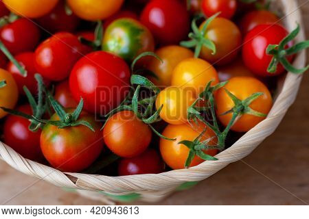 Red And Yellow Cherry Tomatoes Bowl Top View. Harvest Vegetables. Tomato On The Table. Vitamin Healt