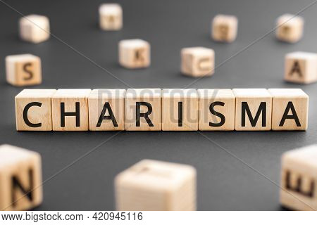 Charisma - Word From Wooden Blocks With Letters, Charisma Concept, Random Letters Around Black Backg
